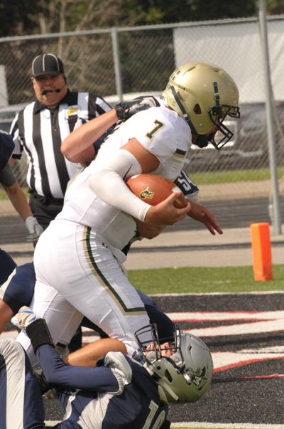 Nathan Helm drags a couple of Blue Dons across the goal line for 2 pt conversion.JPG