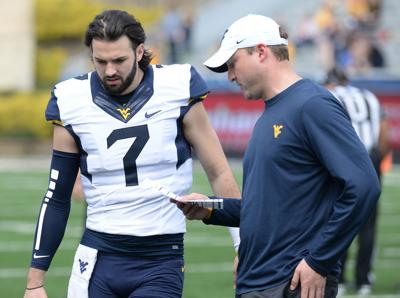 Will Grier with Jake Spavital