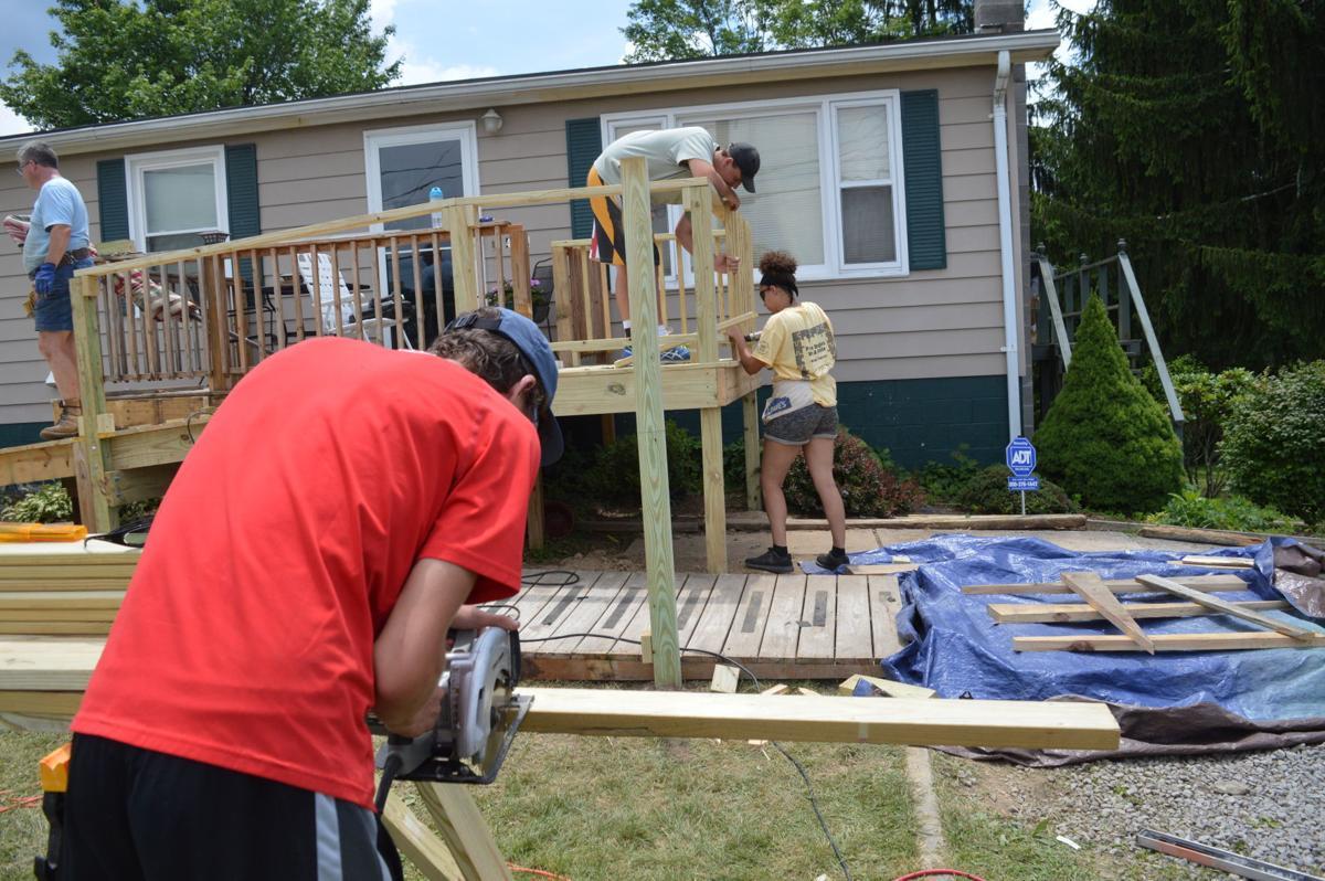 Summer Home Repair Program: Working on top boards