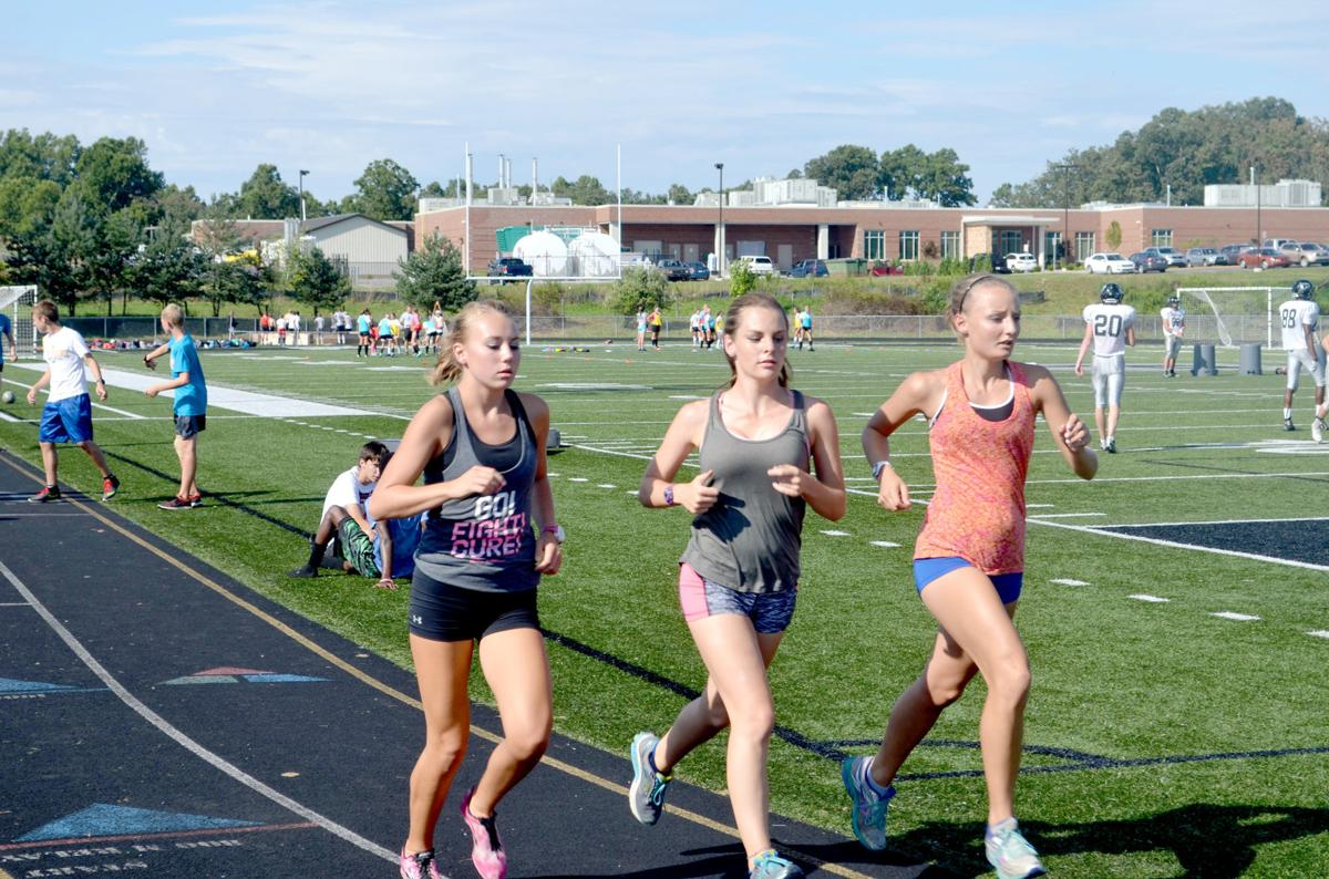 Jenna Lenhart and Tori Carr running repeats