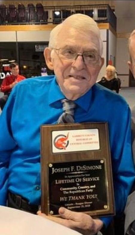 DiSimone with award