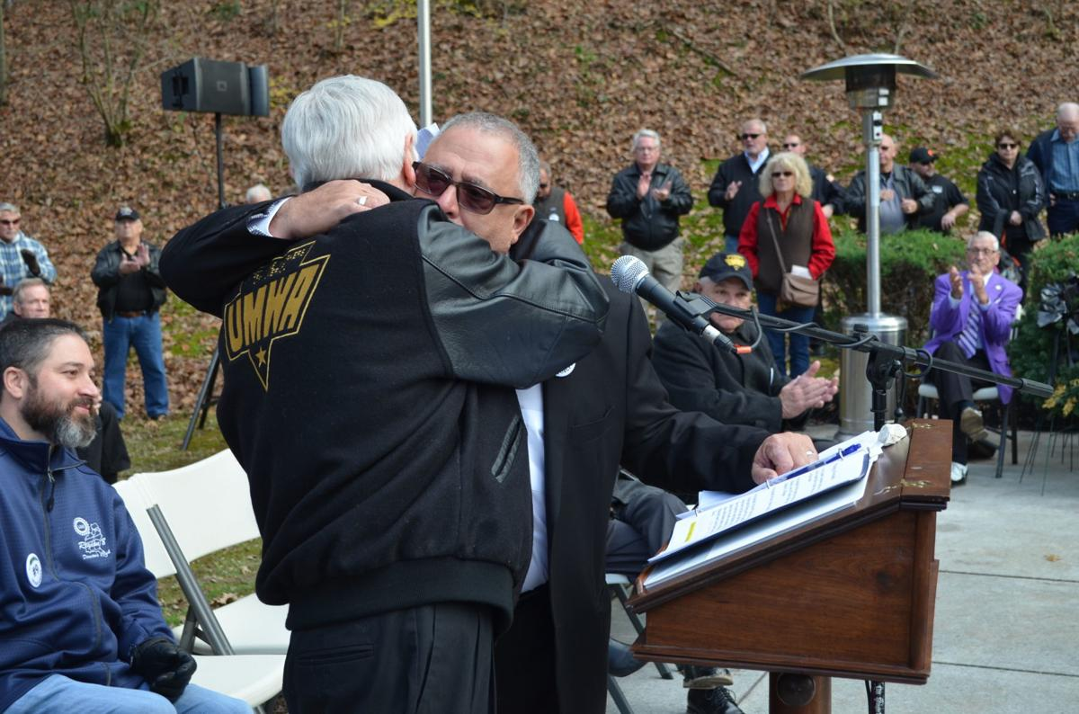 Roberts and Caputo embrace