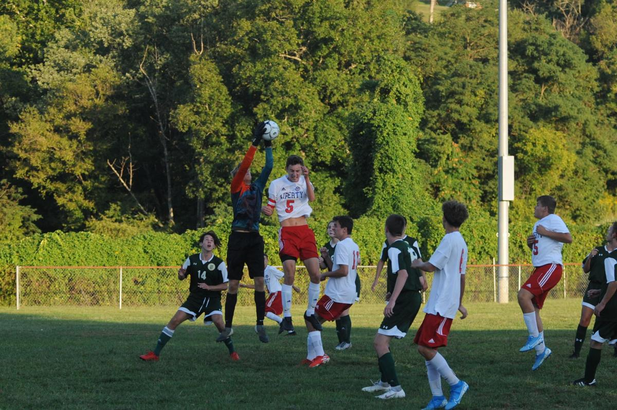 nd goalie catches corner kick just above lib 5.JPG