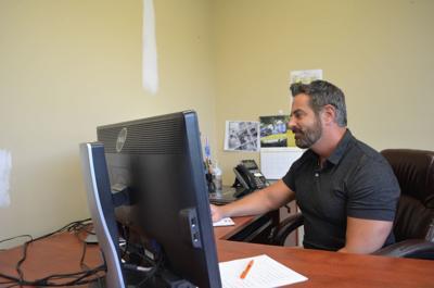 Mark Miller at desk