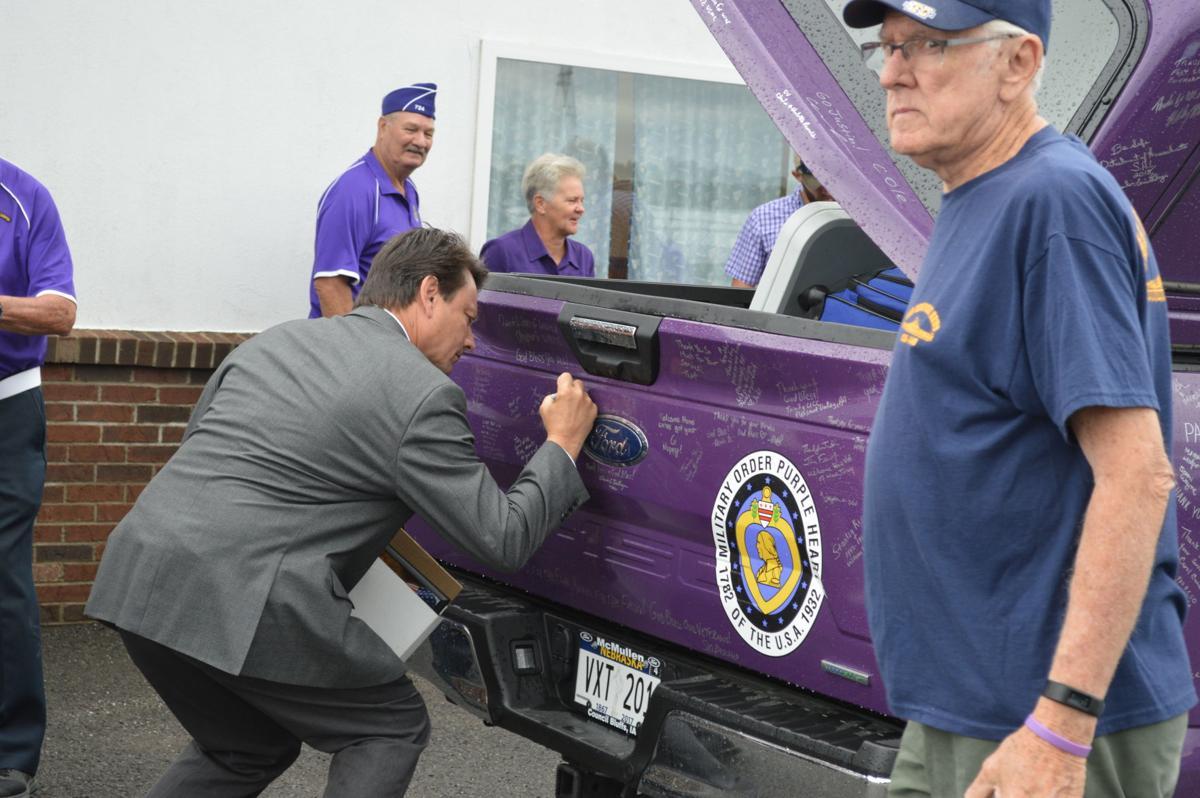 VanGilder signs the truck