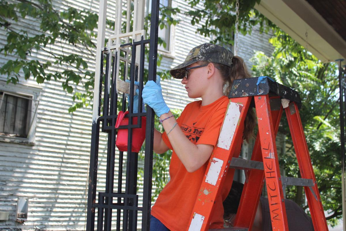 Church volunteers painting