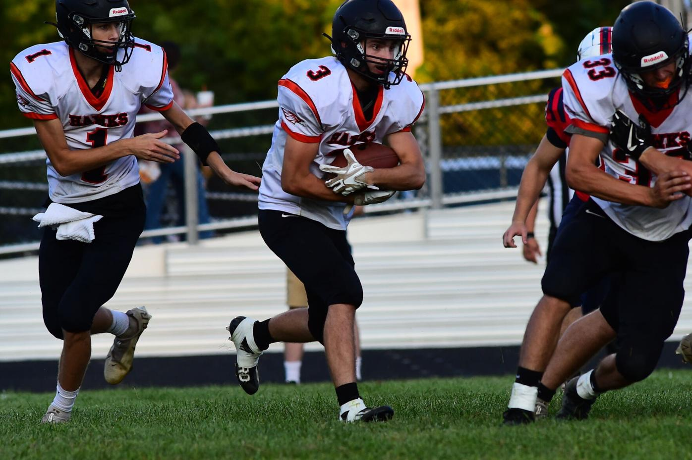 Jacob Haddix takes the hand off from Caden Davis with Parker Bunch lead blocking.JPG