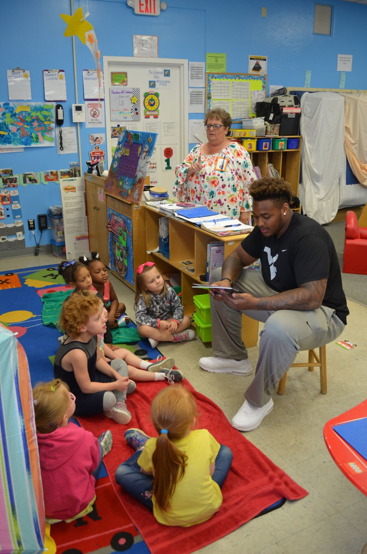 Stills reads to students