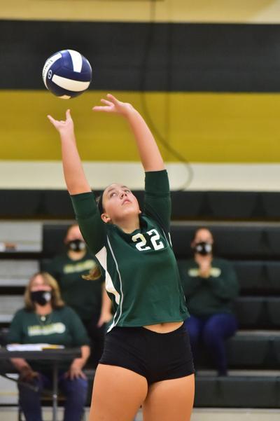 Zyla Lanham pushes the ball over the net.JPG