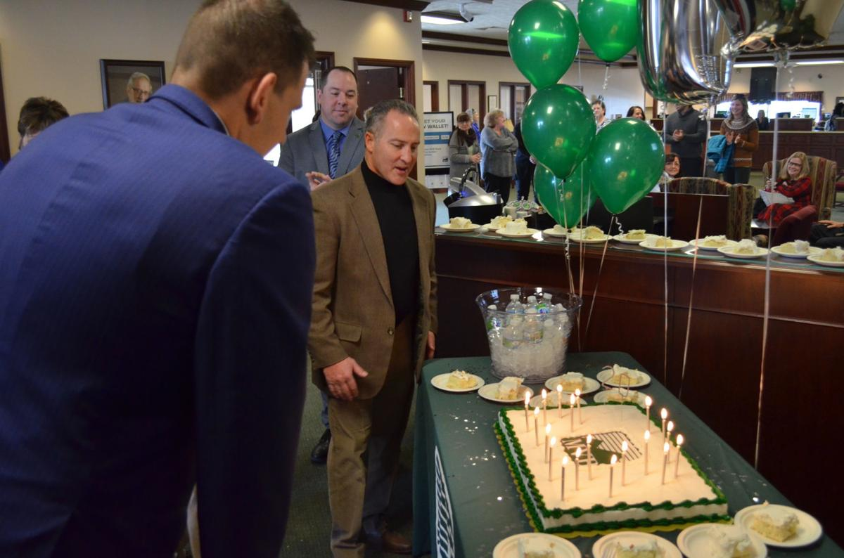MVB Bank birthday — blowing out the candles