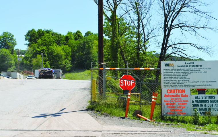 Waste haulers pull up to the weigh station at Meadowfill landfill in Bridgeport.
