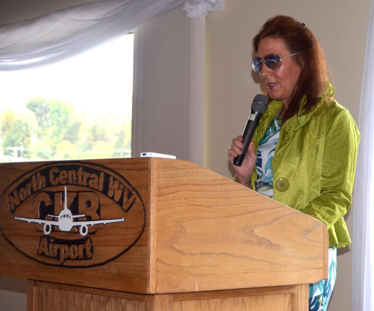 Miller speaking at event