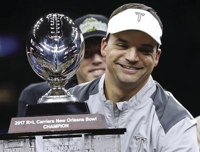 0102 Neal Brown with trophy front copy.jpg