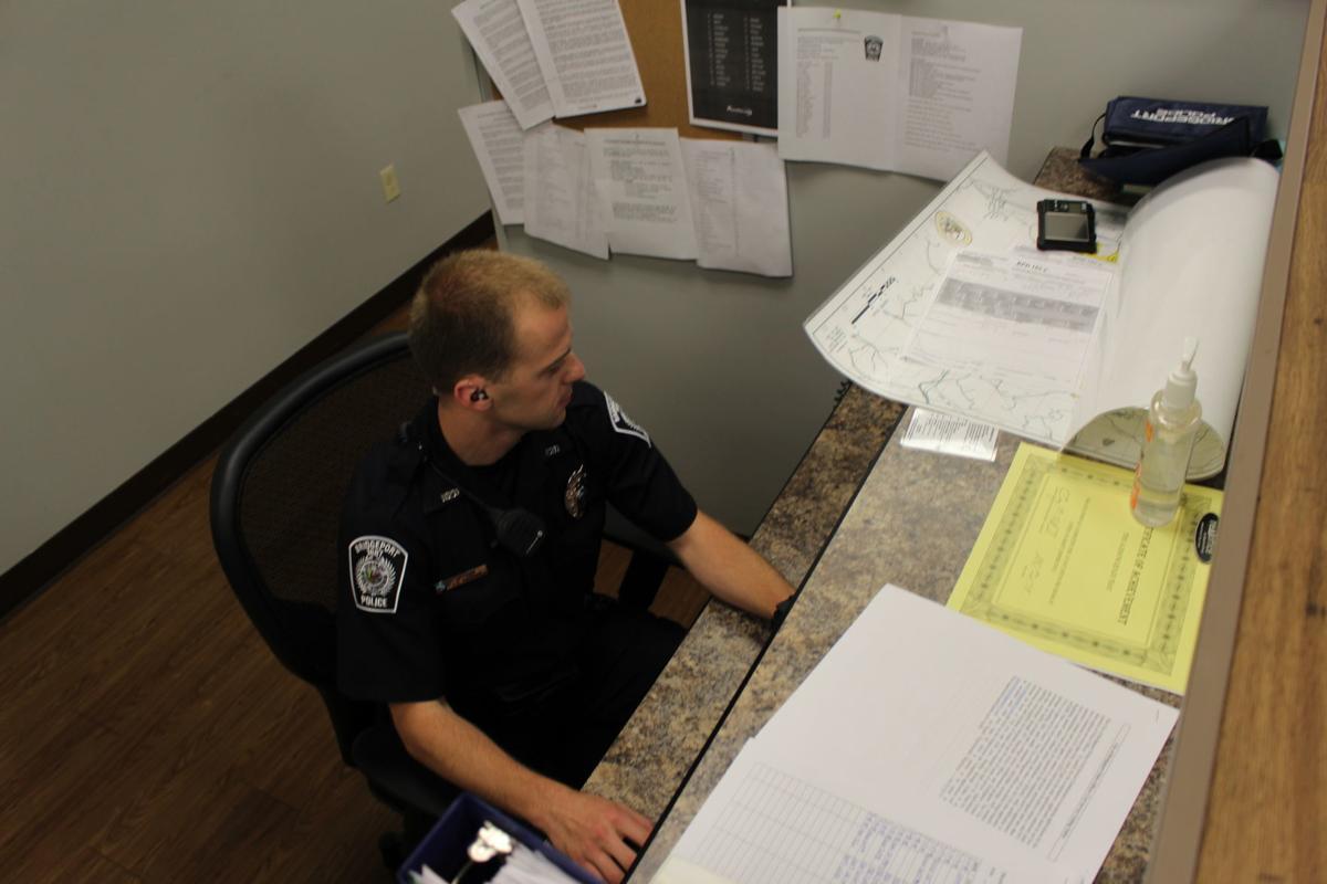 Officer J.D. Manson at desk