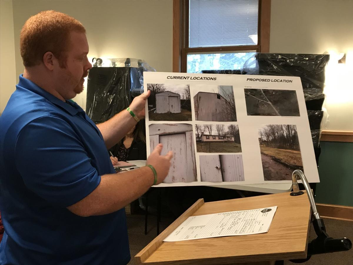 Anthony Powell with building photos