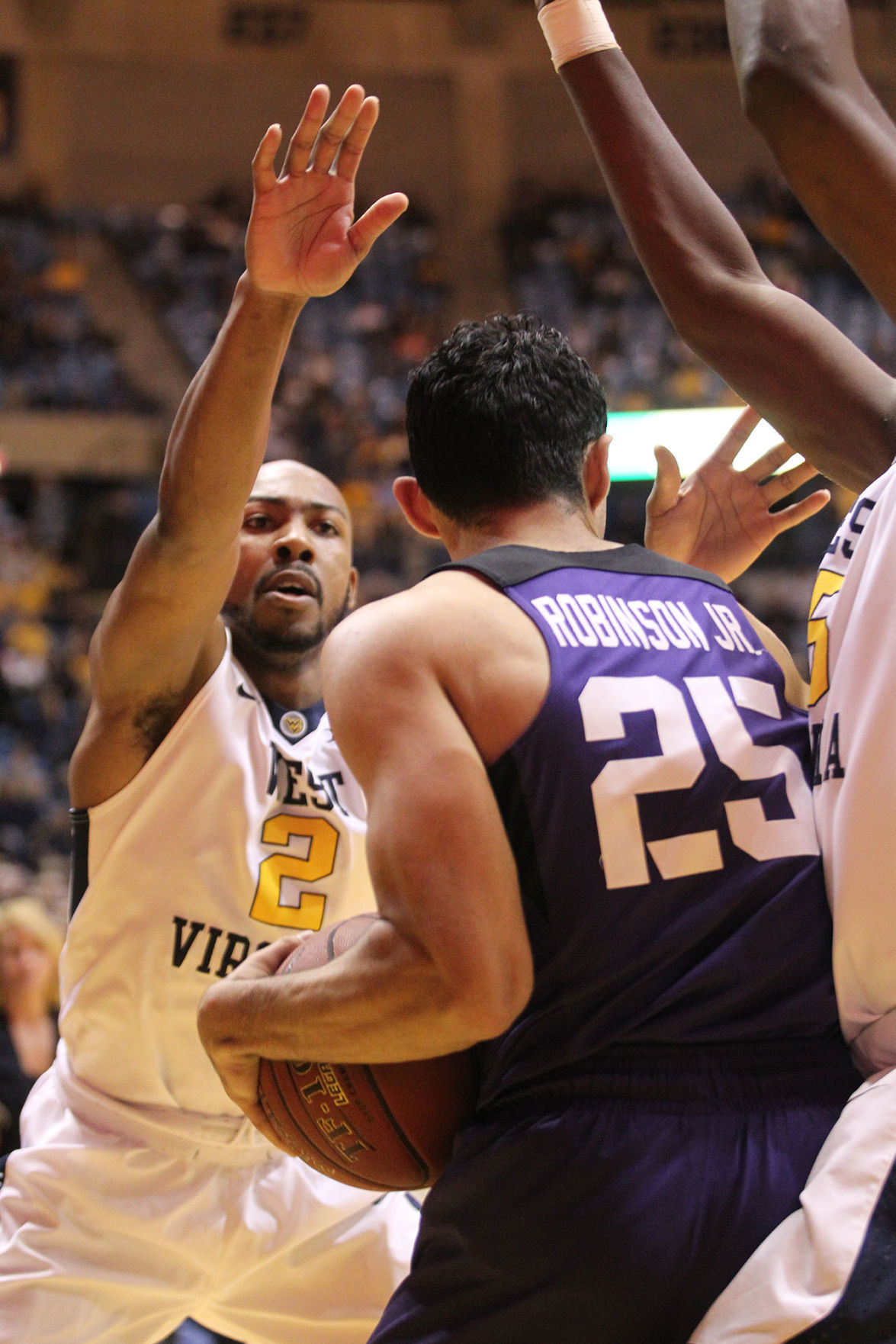 0212 WVU basketball Jevon Carter hands up.jpg