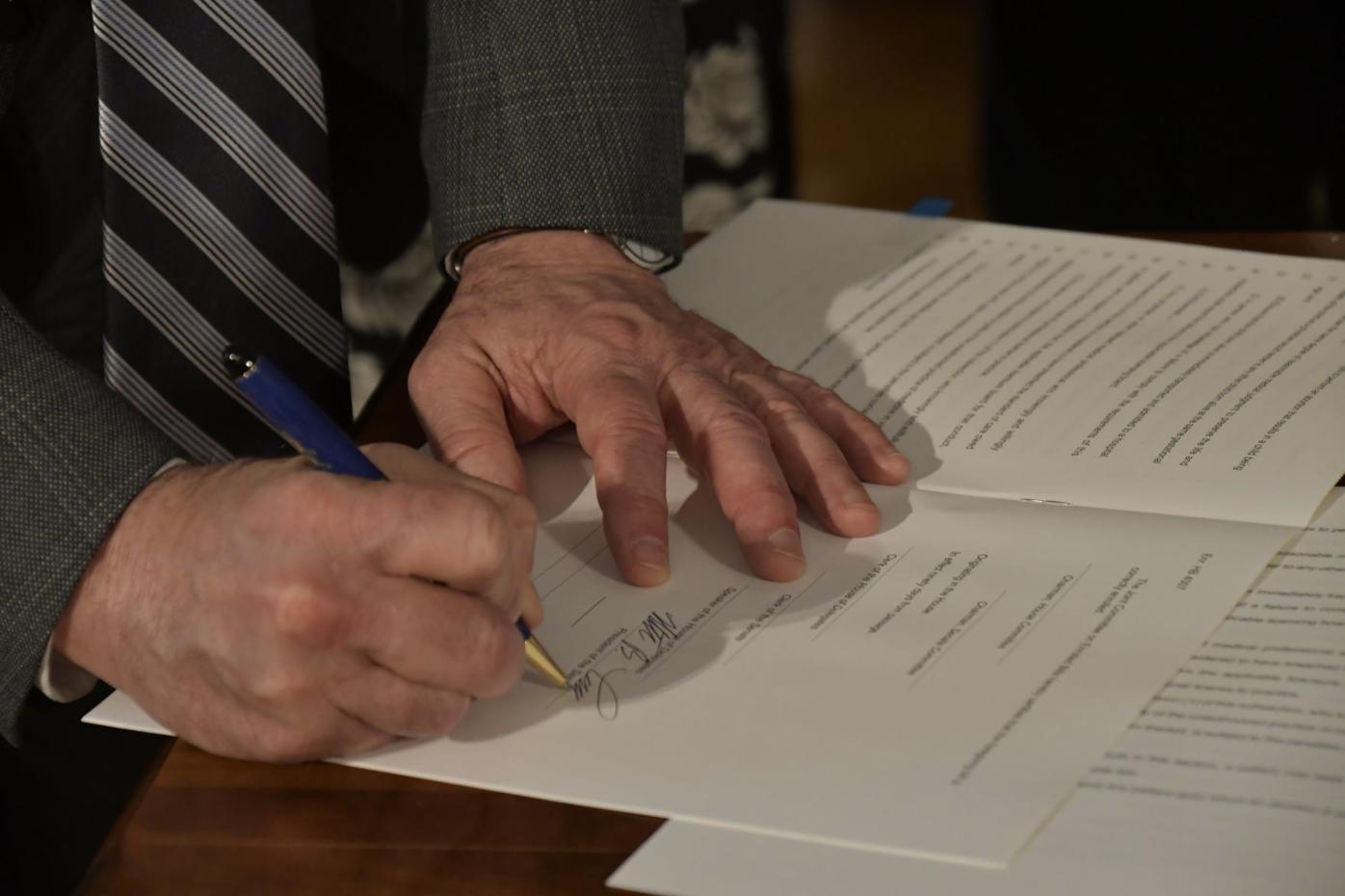 Justice signing bill