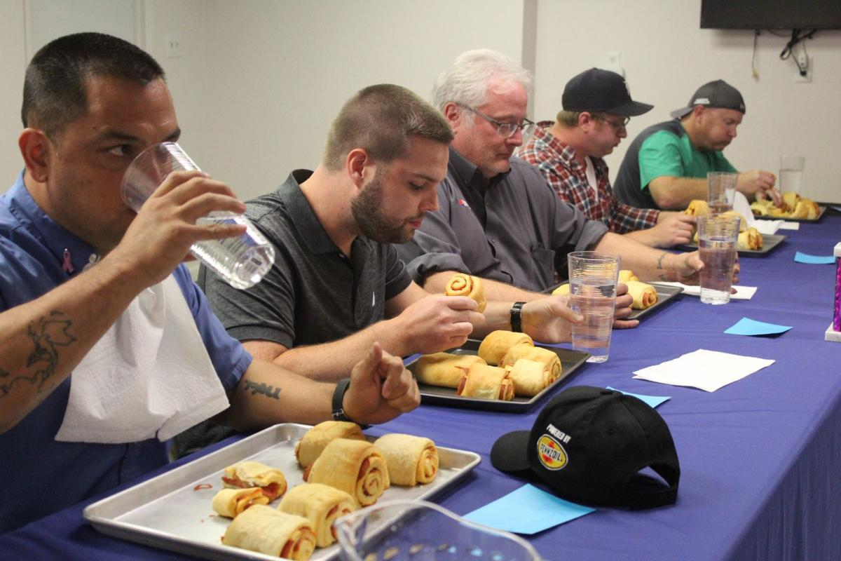 Contestants at pepperoni roll eating contest