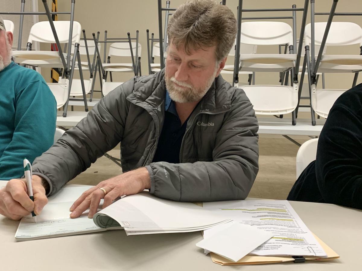 Mayor Dawson signs checks