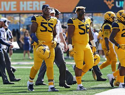 WVU football 1009 Dante and Darius Stills walk front