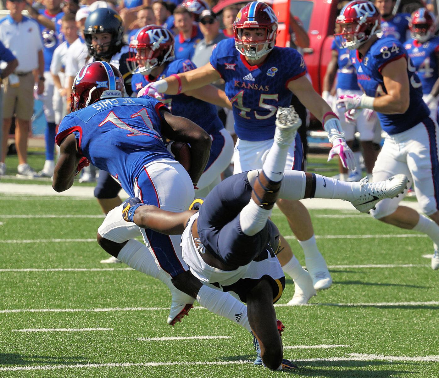 WVU's Quondarius Qualls tries to stop Kansas receiver Steven Sims