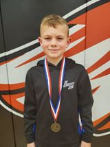 Zeke Brown 1st place 8U 60 pound division
