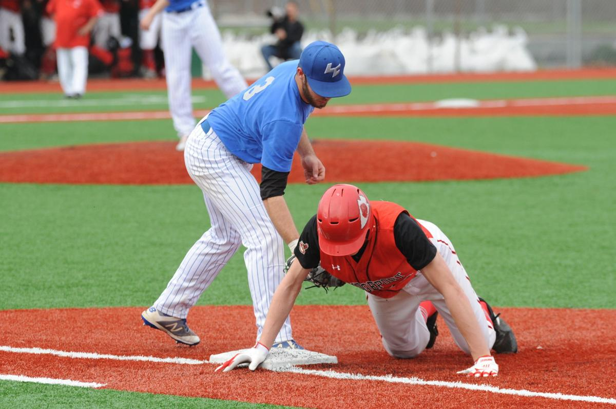 bport 18 safe at 1B after pick off attempt lc 3 1B covering.JPG