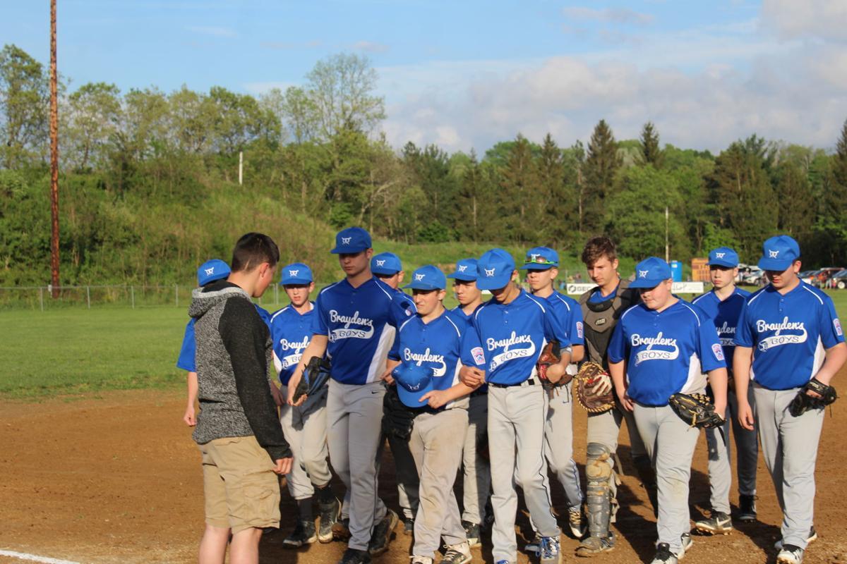 Brayden's Boys walk off the field