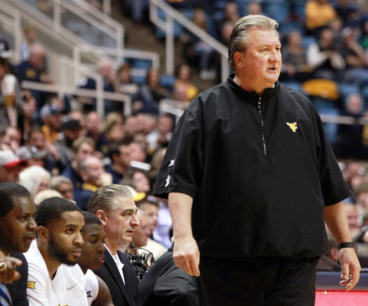 huggs mad at schedule makers as big 12 tips wvu sports