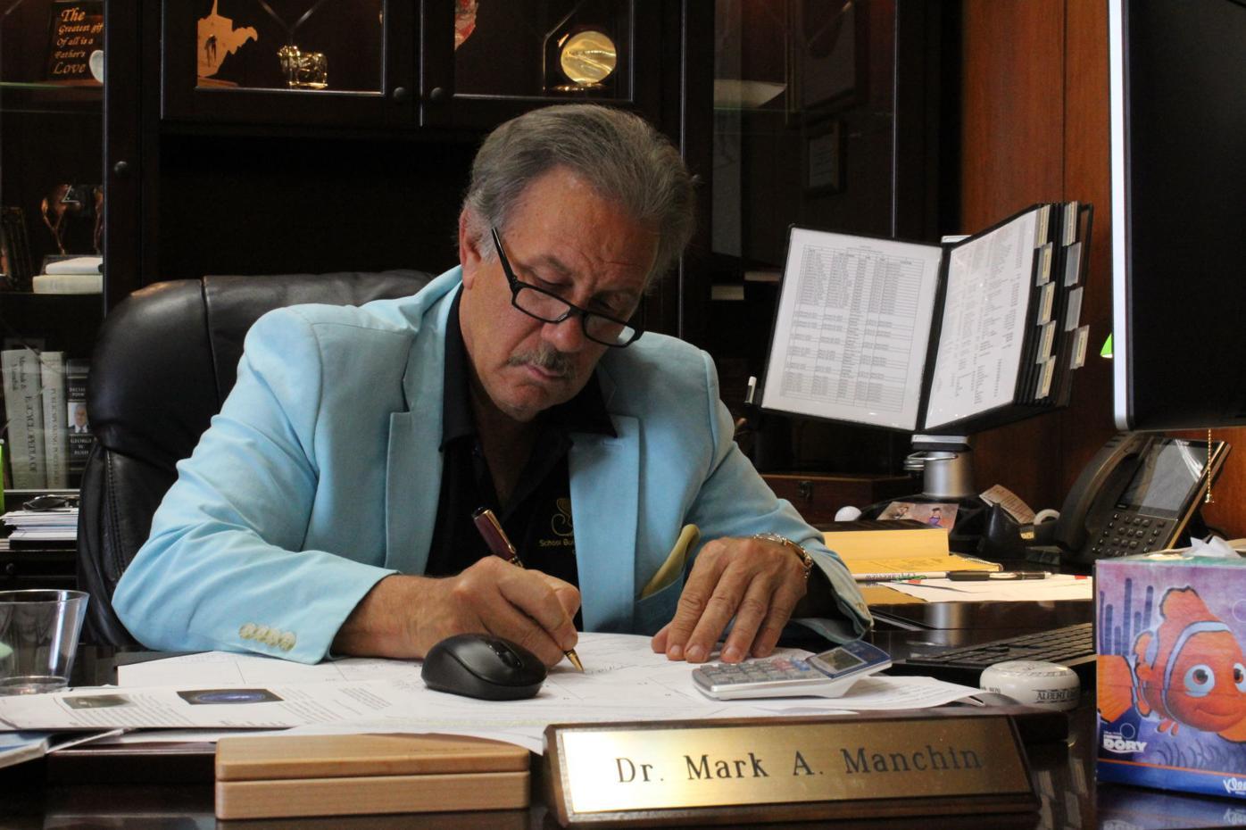 Mark Manchin at desk