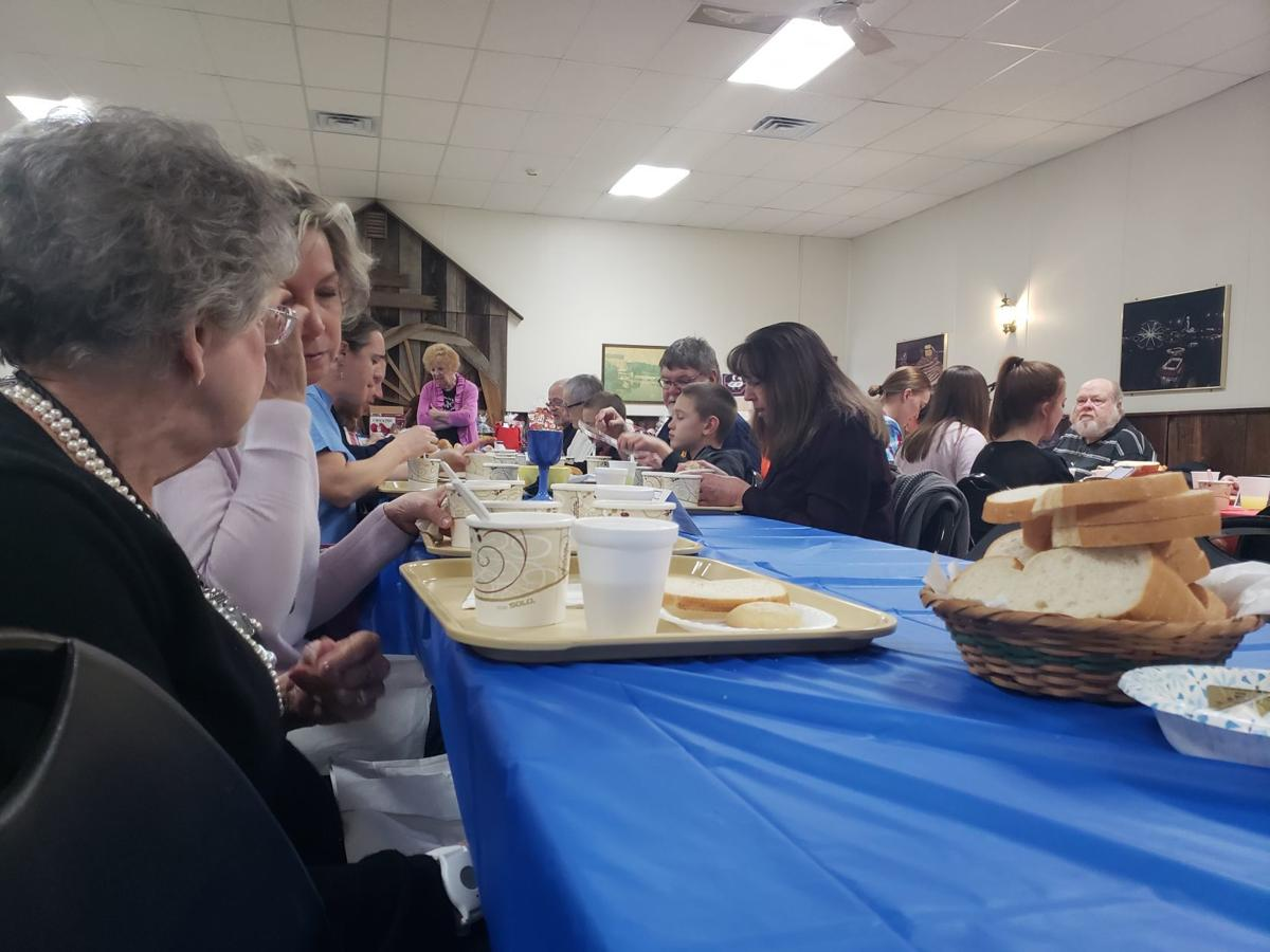 People at table for Empty Bowls