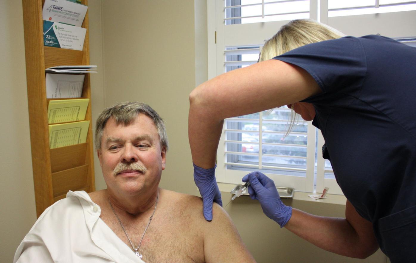 Jennifer Goldcamp gives a flu shot