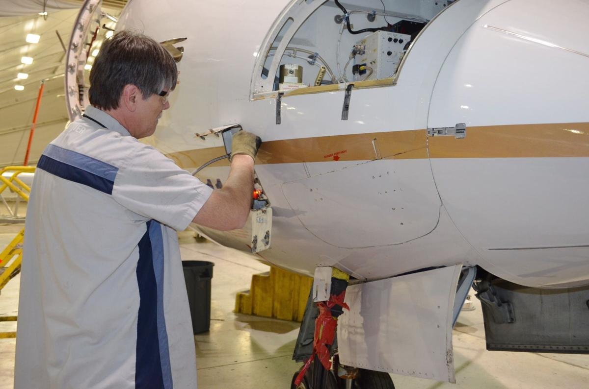 Bombardier mechanic working