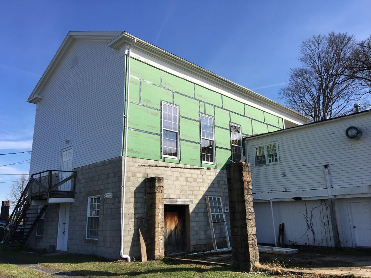 Center Hall siding being replaced