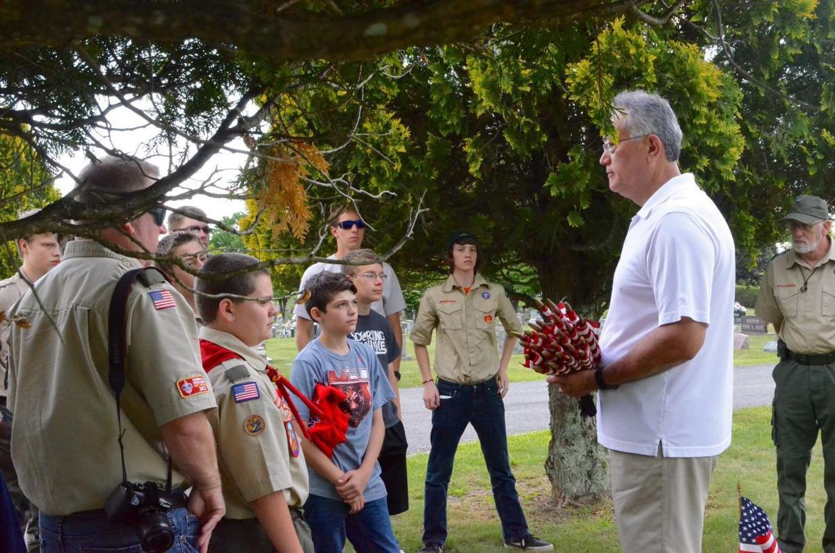 Boy Scouts place over 1,300 flags on veteran graves | Local
