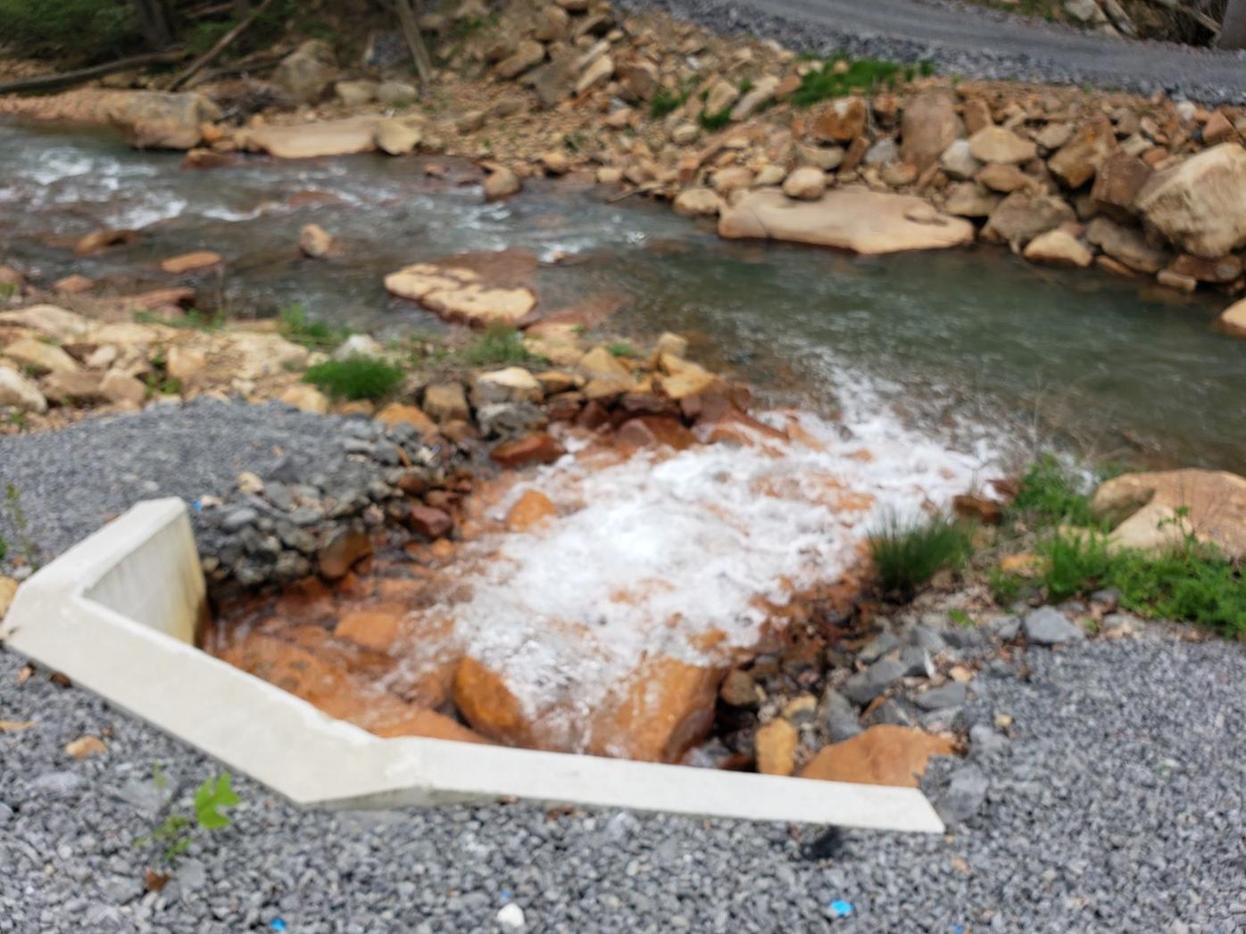 Treated water entering Muddy Creek