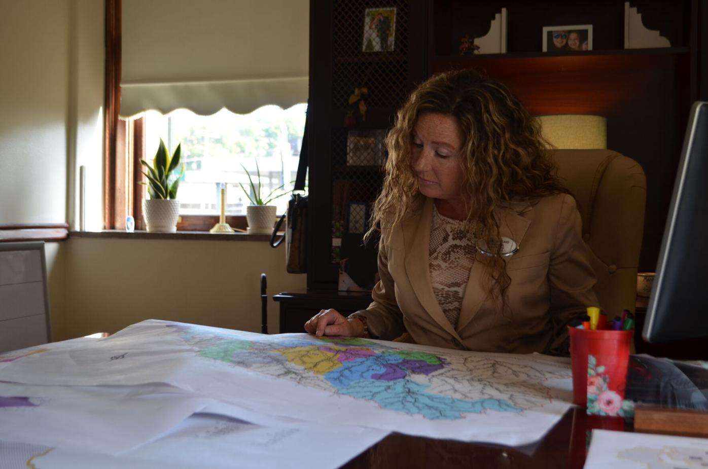 Kincaid examines map