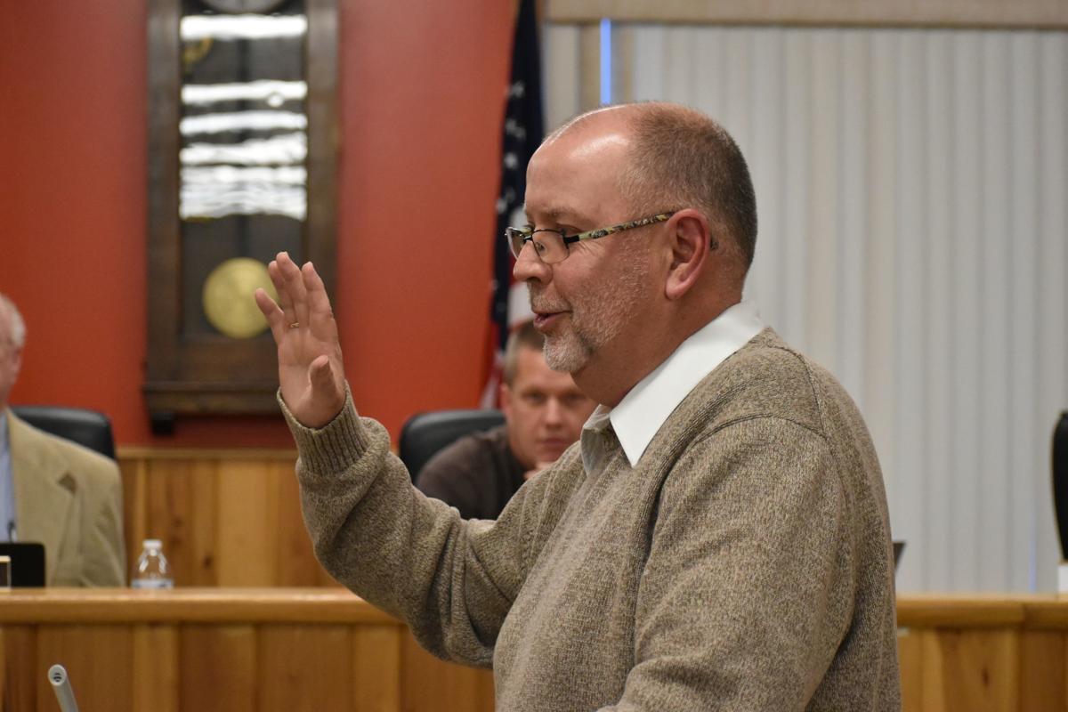 Bruce Huggins being sworn in