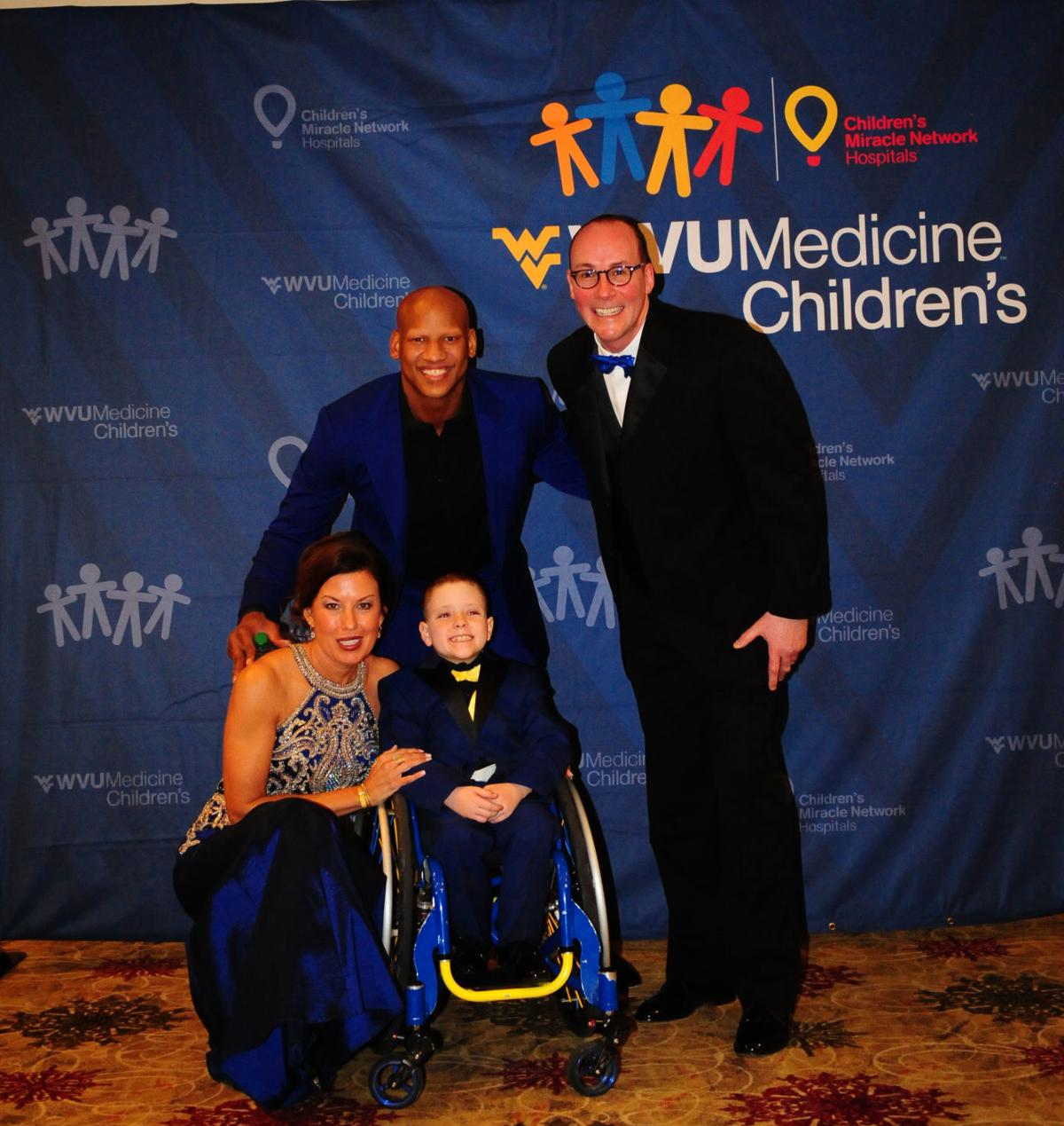 WVU Medicine Children's COO Amy Bush-Marone, Steelers great Ryan Shazier, WVU Children's Miracle Network Champion Brantly Poling and WVU Medicine CEO and President Dr. Albert Wright