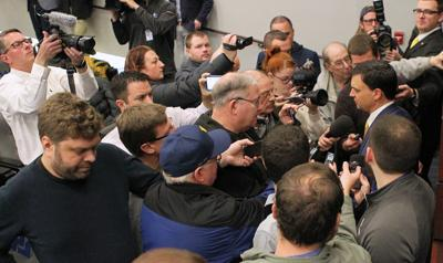 0110 Neal Brown surrounded by media copy.jpg