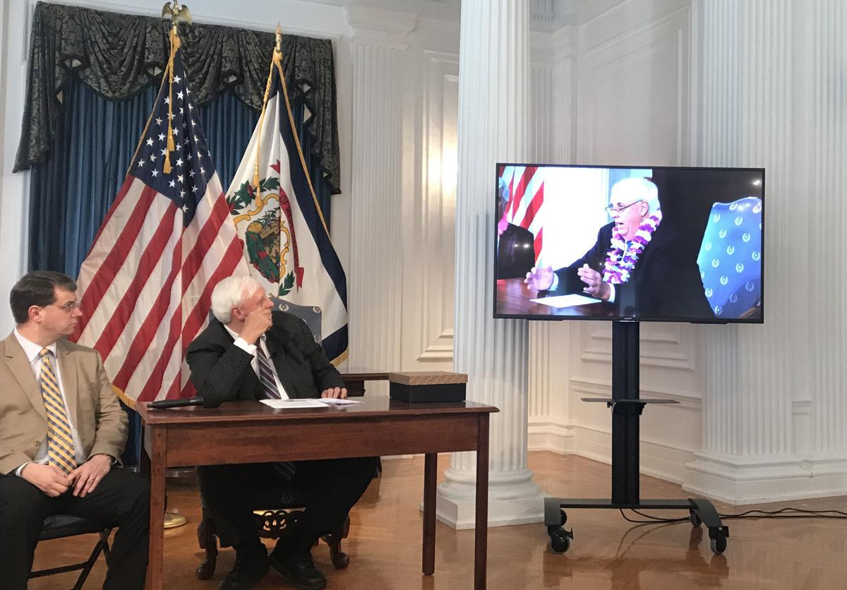 Jim Justice shows video