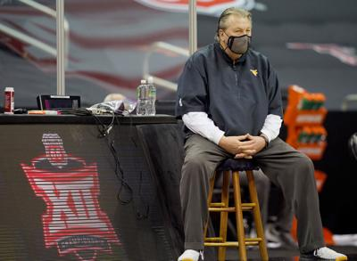 Huggins watches the action