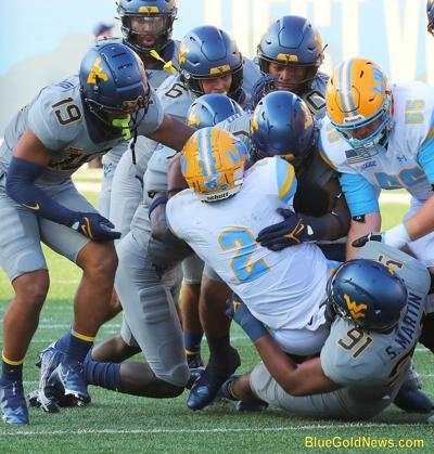 WVU Football Defense Gang Tackle.JPG