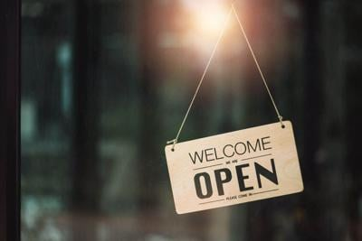 """""""Open"""" on cafe or restaurant hang on door at entrance."""