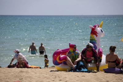 Europe tells tourists: Welcome back! Now work out the rules
