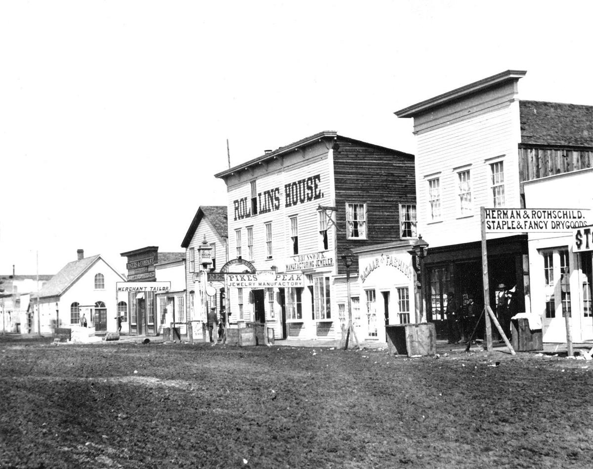 Rollins House and other storefronts, 1869