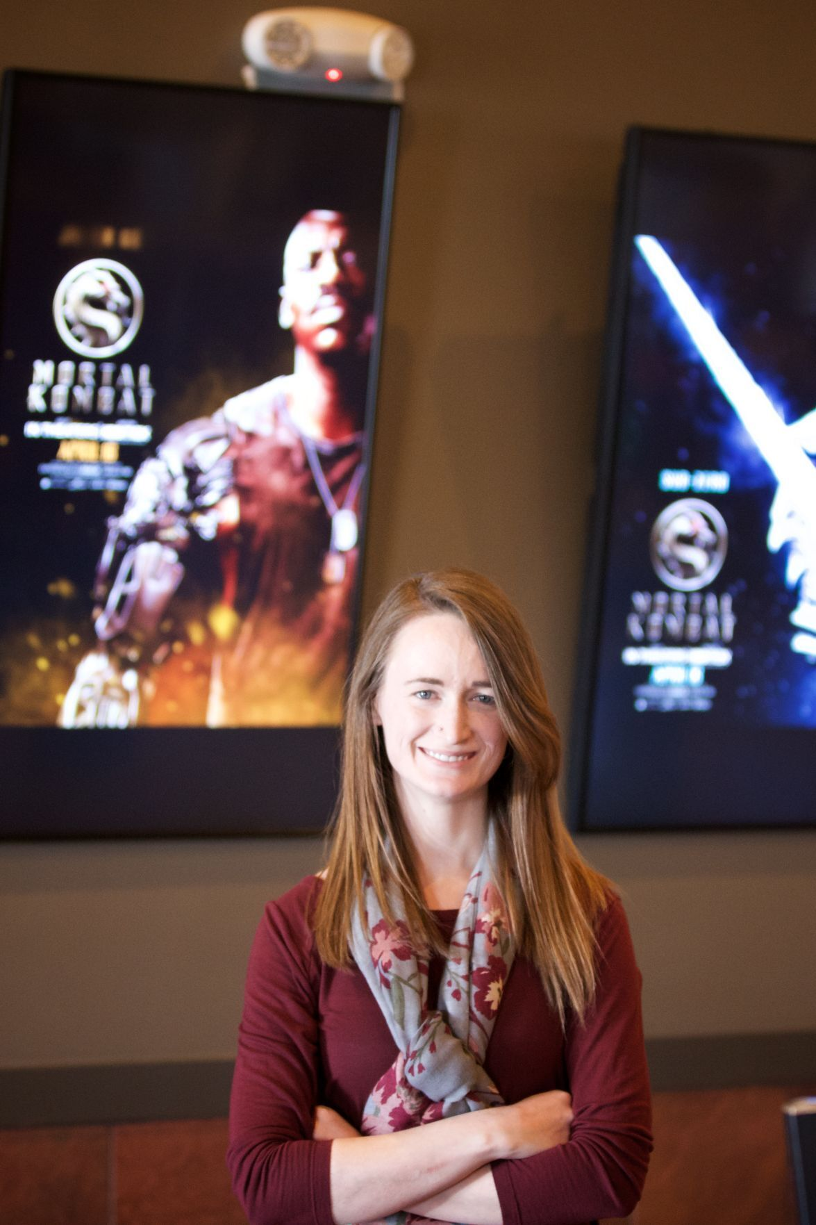 Alainie Crawford with movie posters