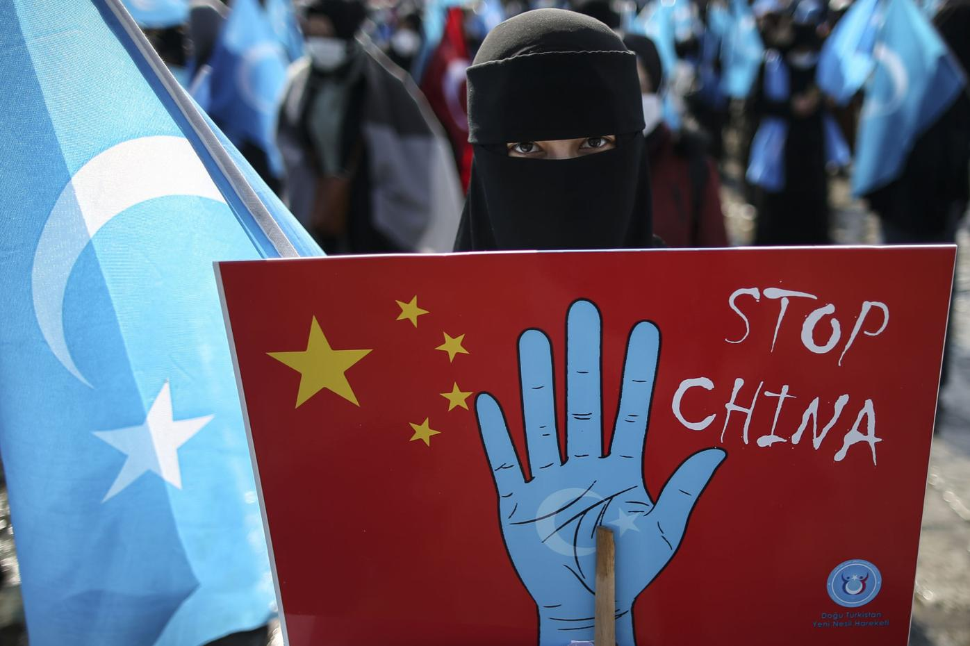 APTOPIX Turkey China Uyghurs cover