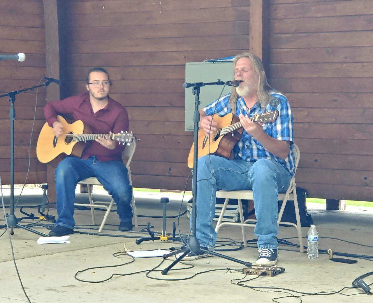 """Local performers, Steve Davis, right and Chuck Dittman, left played an acoustic version of """"Star Bangled Banner"""" during the flag ceremony in Bunning Park."""