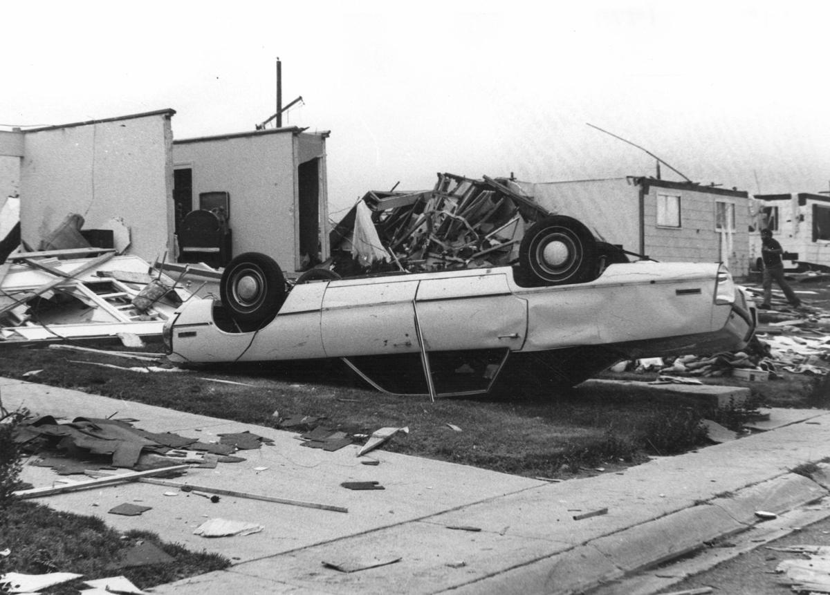 Neg 35-275, Cheyenne Tornado, 1979, house destroyed and car upside down.jpg